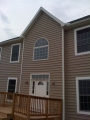 Select shutters or wide lineal trim around windows.