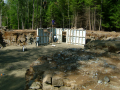 Pre-cast walls are craned onto compacted, leveled pea gravel.