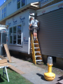 Some siding installation is done on site; much is done at the factory.